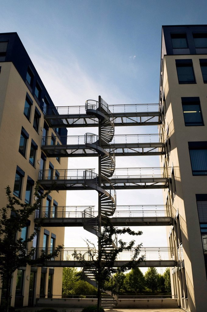 Modern office buildings, architecture, with a steel spiral staircase and bridges connecting the buildings, near Munich, Bavaria, Germany, Europe : Stock Photo