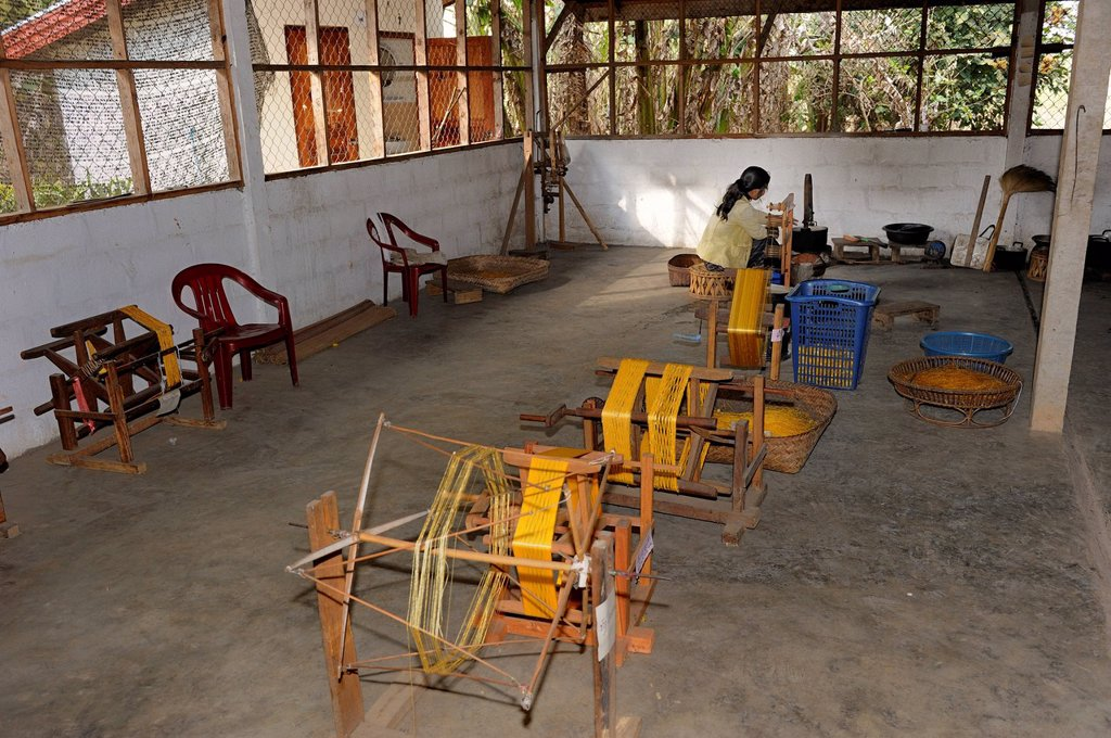 Spinning works at a silk factory in the city of Phansavan, Laos, Southeast Asia, Asia : Stock Photo