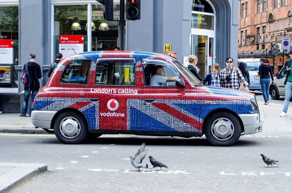 London taxi with colourful advertising, London, South England, England, United Kingdom, Europe : Stock Photo
