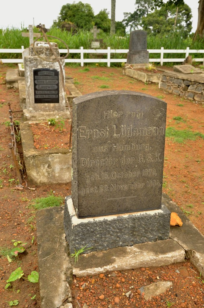 Grave stones in the German cemetery beside the Old German Church of the Catholic Pallottine Mission of Kribi, Cameroon, Central Africa, Africa : Stock Photo