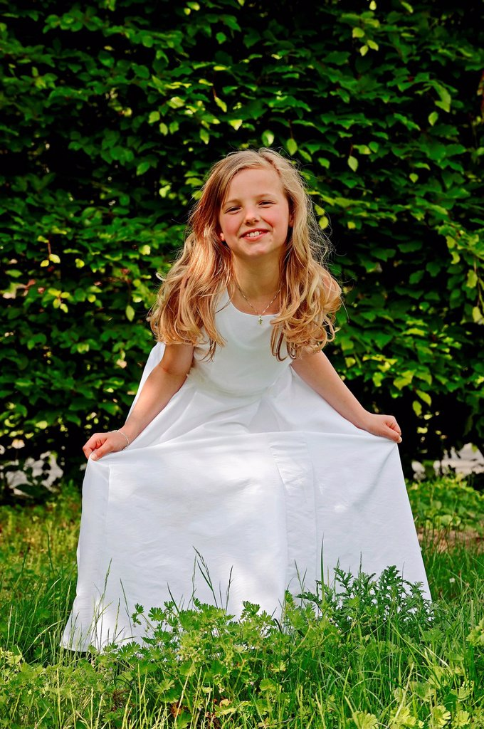 Stock Photo: 1848-624437 Girl, 9 years, in a white First Communion dress, Muensterland region, North Rhine_Westphalia, Germany, Europe