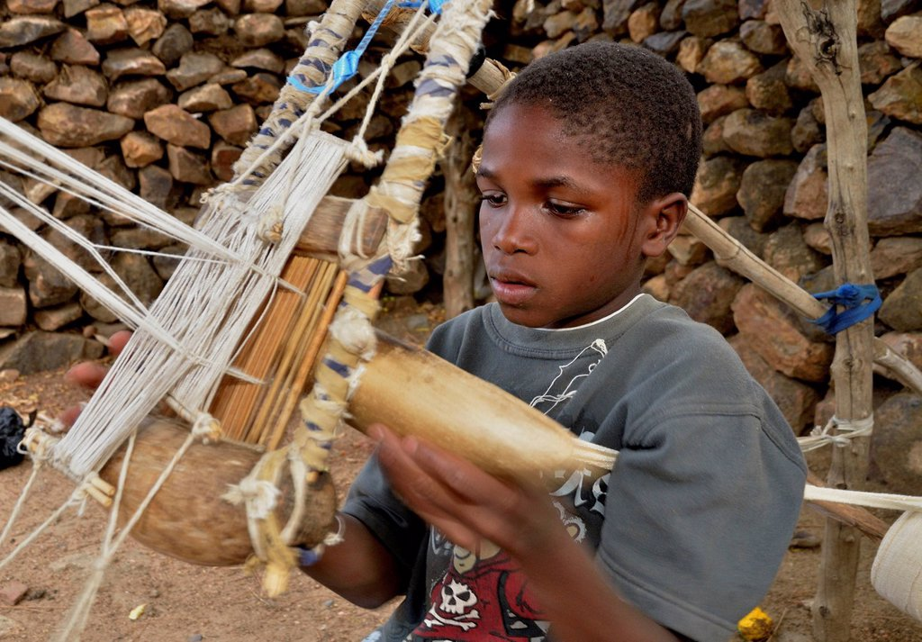 Stock Photo: 1848-624801 Boy working on a loom in the village of Rhumsiki, Cameroon, Central Africa, Africa