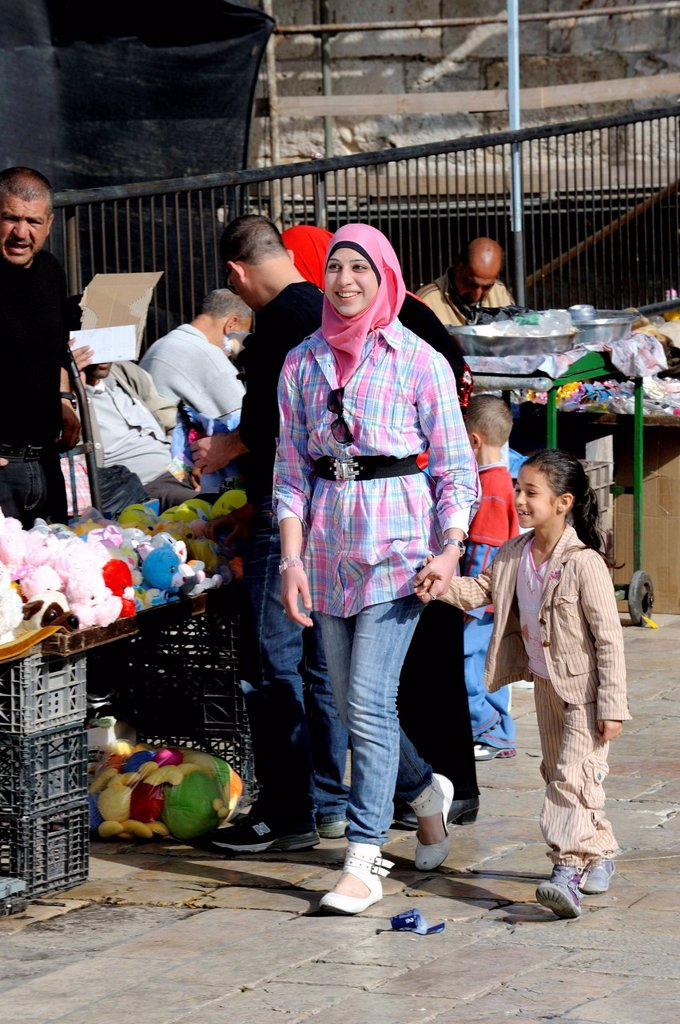 Stock Photo: 1848-625837 Palestinian woman with a headscarf and fashionable clothing, holding a girl by the hand at the Damascus Gate, Muslim Quarter, Jerusalem, Israel, Western Asia, Middle East