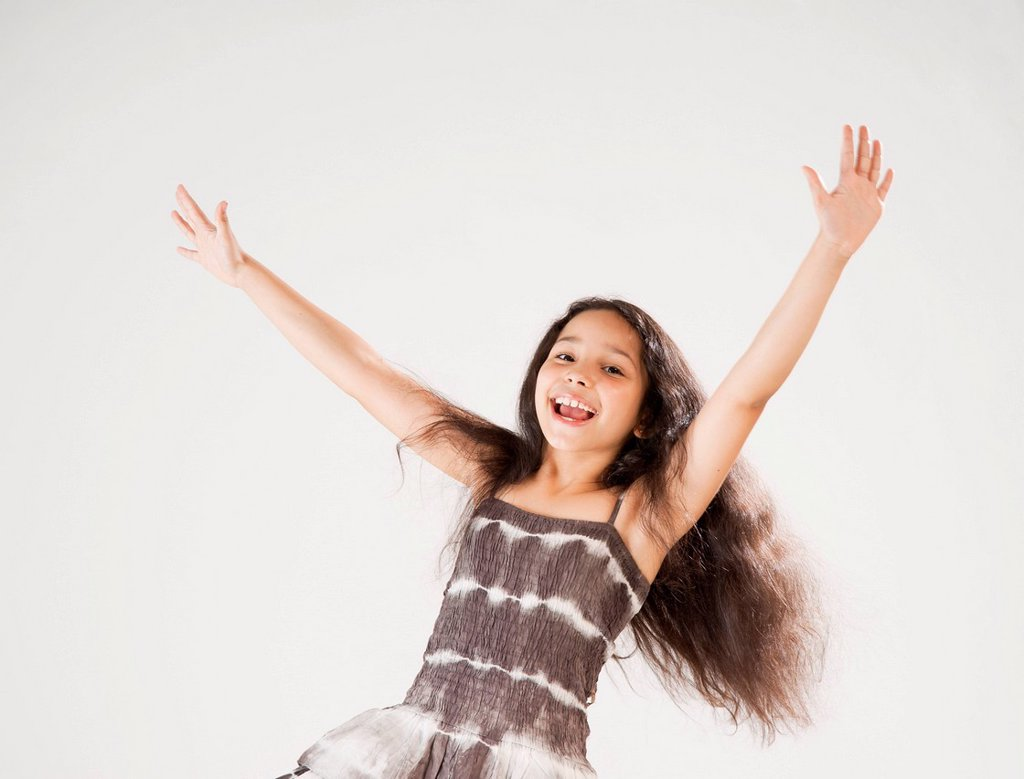 Girl dancing and stretching out her arms : Stock Photo