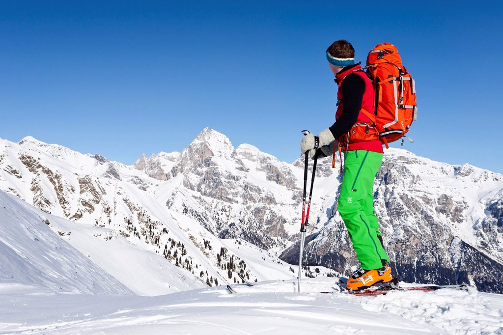 Backcountry skier during the ascent to the peak of Seeberspitz mountain in the Pflerschtal valley above Innerpflersch and the Toffring Alm alp, Tribulaun mountain at the back, province of Bolzano_Bozen, Italy, Europe : Stock Photo