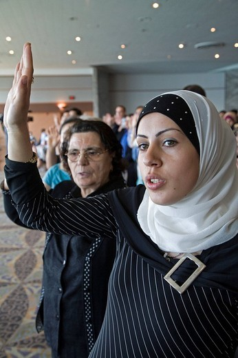 Afaf Ahmad, an immigrant from Lebanon, is one of 600 immigrants sworn in as new citizens of the United States, Detroit, Michigan, USA : Stock Photo