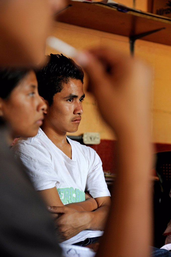 Young man, 16 years old, discussion, Escuela Ceiba school, Lomas de Santa Faz slum, Guatemala City, Guatemala, Central America : Stock Photo