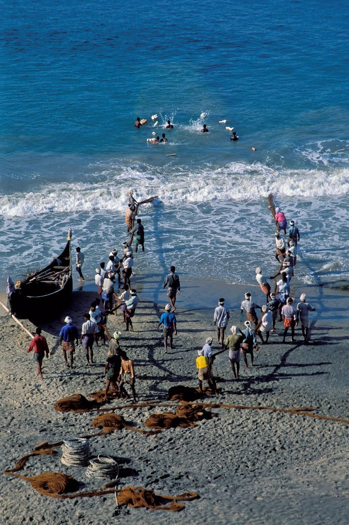 Fishermen pulling in their nets, beach, Kovalam, Kerala, South India, India, Asia : Stock Photo