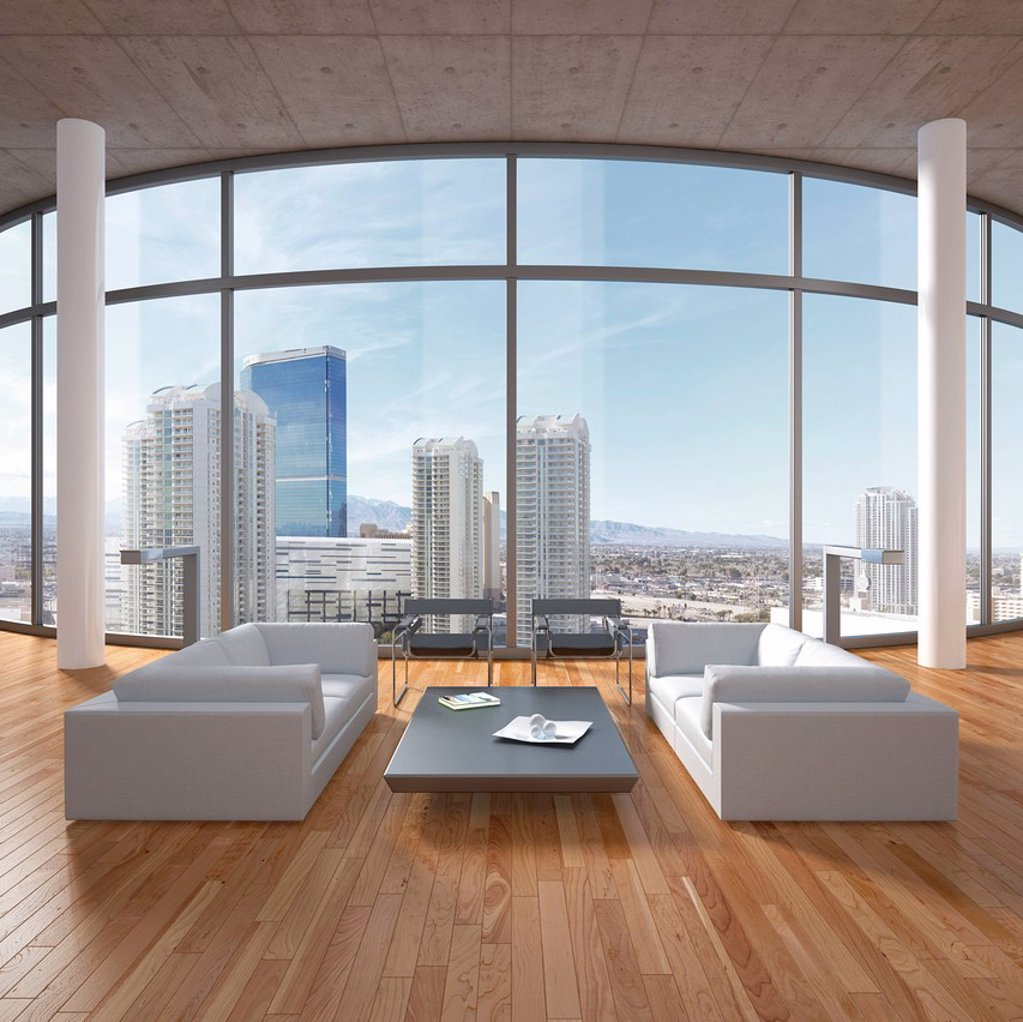 Stock Photo: 1848-631290 Loft_like living room with sofas, coffee table, columns and oak flooring, urban views, 3D illustration