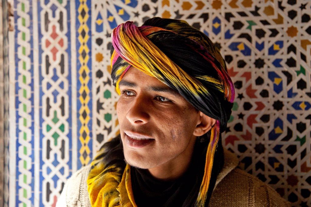 Stock Photo: 1848-631651 Young Berber man in front of a Zellij mosaic made of terracotta tiles, Telouet Kasbah, Telouet, Ounila Valley, High Atlas Mountains, Morocco, Africa