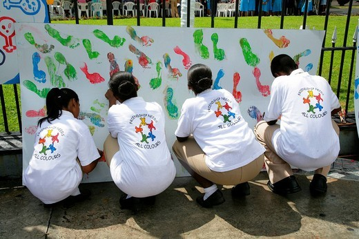 Stock Photo: 1848-6341 Multi_coloured footprints as a symbol of cooperation between people of various ethnic backgrounds during a protest against violence against women in Georgetown, Guyana, South America