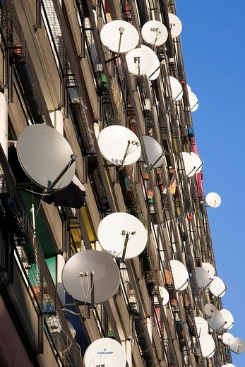 Lots of satellite dishes mounted to balconies on an apartment building facade, Pallasseum or Berlin Social Palace Berliner Sozialpalast apartment block in Schoenberg, Berlin, Germany, Europe : Stock Photo