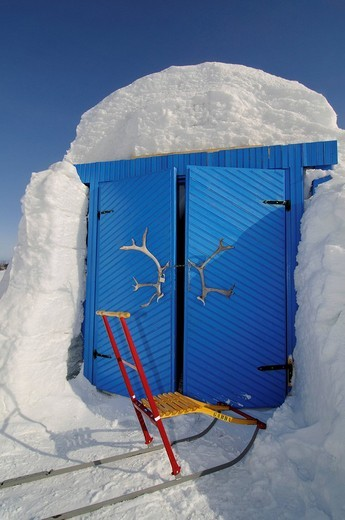 Entry doors to the igloo_hotel with caribou_antlers and sledge, Snow Hotel, Kirkenes, Finnmark, Lapland, Norway, Scandinavia, Europe : Stock Photo