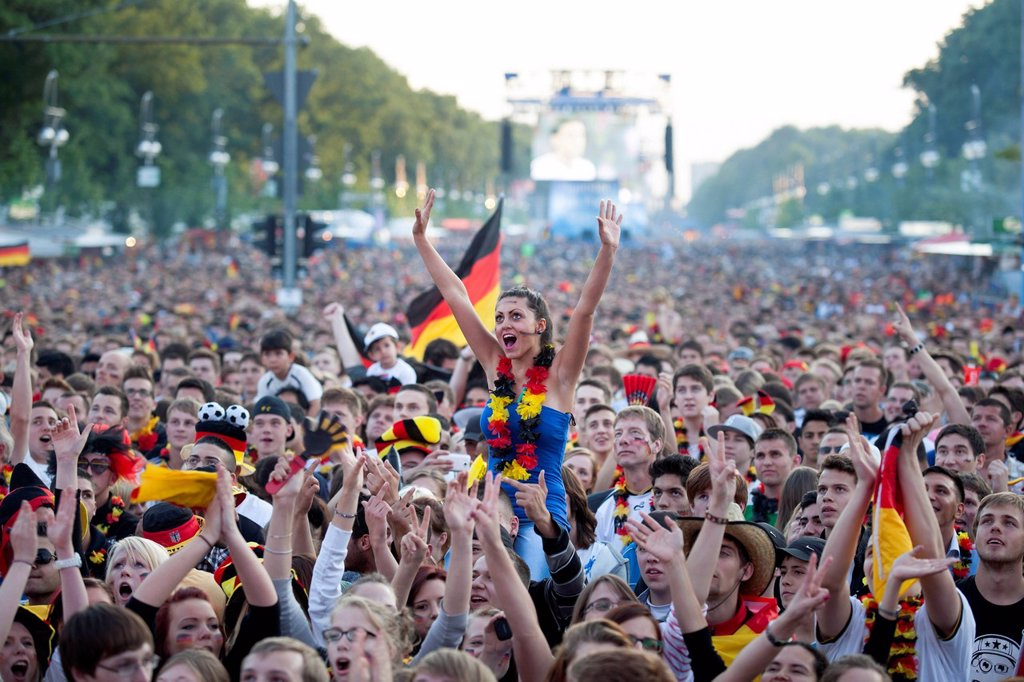 Football fans watching the first match of the German national team during the Euro 2012 championships at Fanpark Berlin, Strasse des 17. Juni street, Berlin, Germany, Europe : Stock Photo