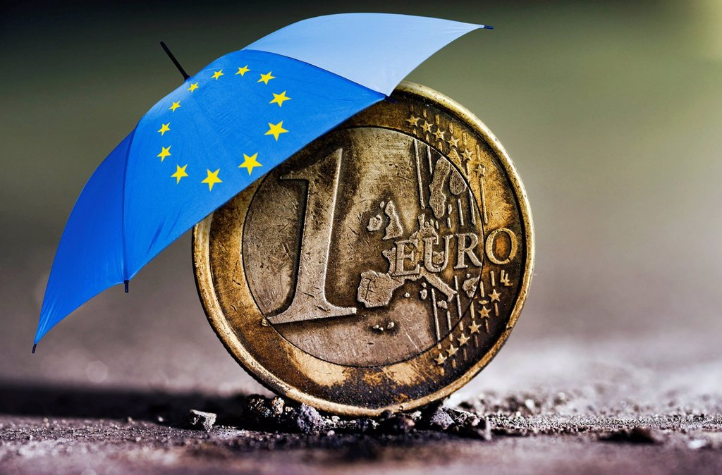 Stock Photo: 1848-647070 Burnt 1 euro coin in ashes under an umbrella with the stars of the EU, symbolic image for the euro crisis, euro rescue package