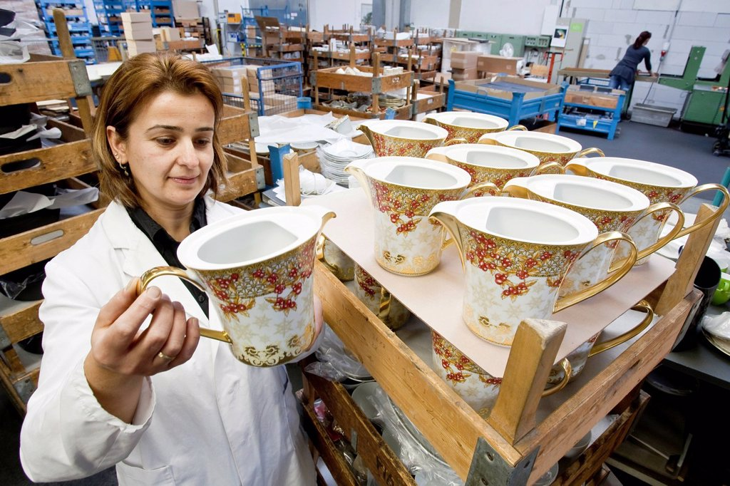 Employee during the final inspection of Versace teapots at the porcelain manufacturer Rosenthal GmbH, Speichersdorf, Bavaria, Germany, Europe : Stock Photo