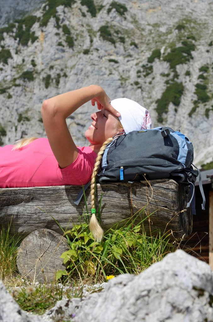 Female hiker taking a break at Gruttenhuette hut, Mt Ellmauer Halt, Wilder Kaiser massif, Tyrol, Austria, Europe : Stock Photo
