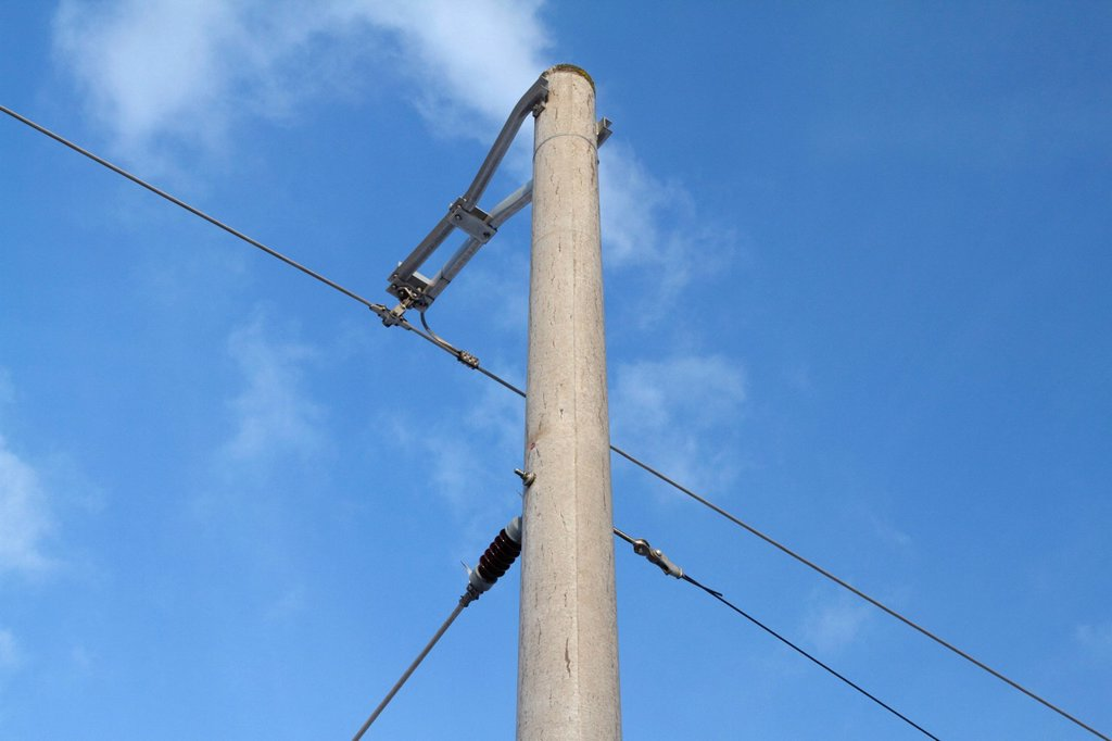 Overhead contact wire at a railway line with blue sky, Hesse, Germany, Europe : Stock Photo