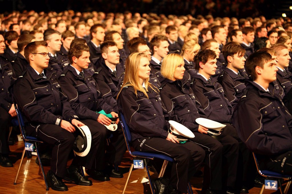 Stock Photo: 1848-647903 Swearing_in ceremony of 1100 policemen and policewomen to the NRW Police Force, Class of 2010, in the Grugahalle in Essen, North Rhine_Westphalia, Germany, Europe