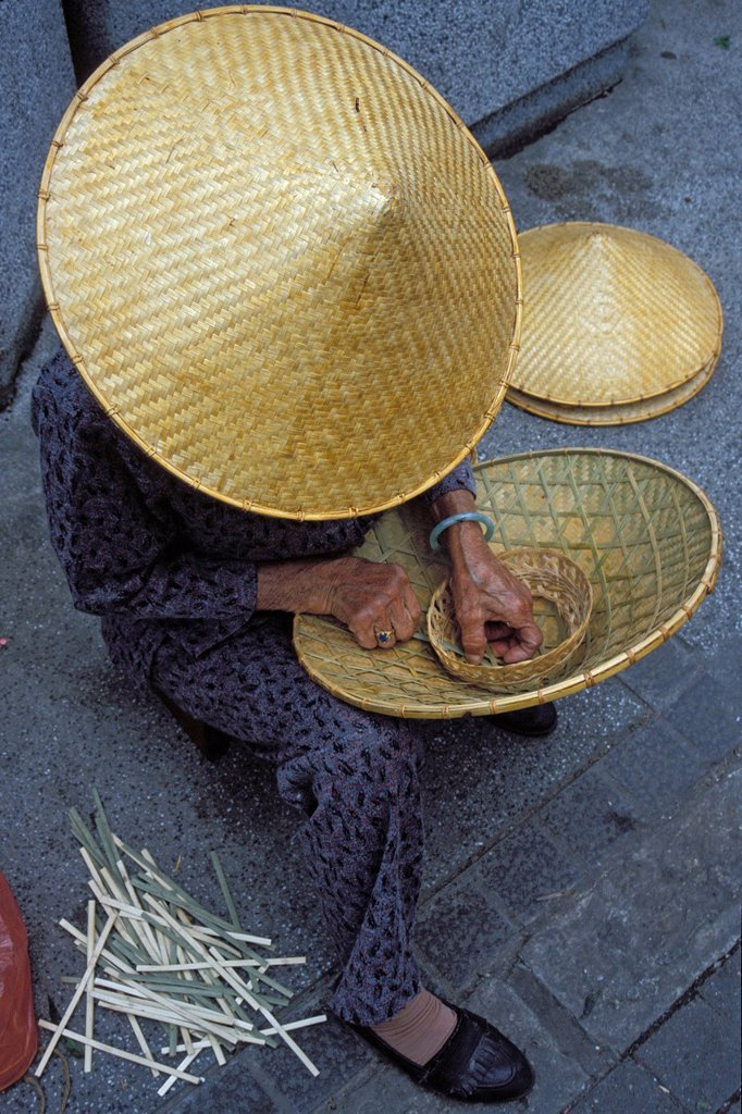 Stock Photo: 1848-647926 Woman weaving a hat, Hong Kong, China, Asia