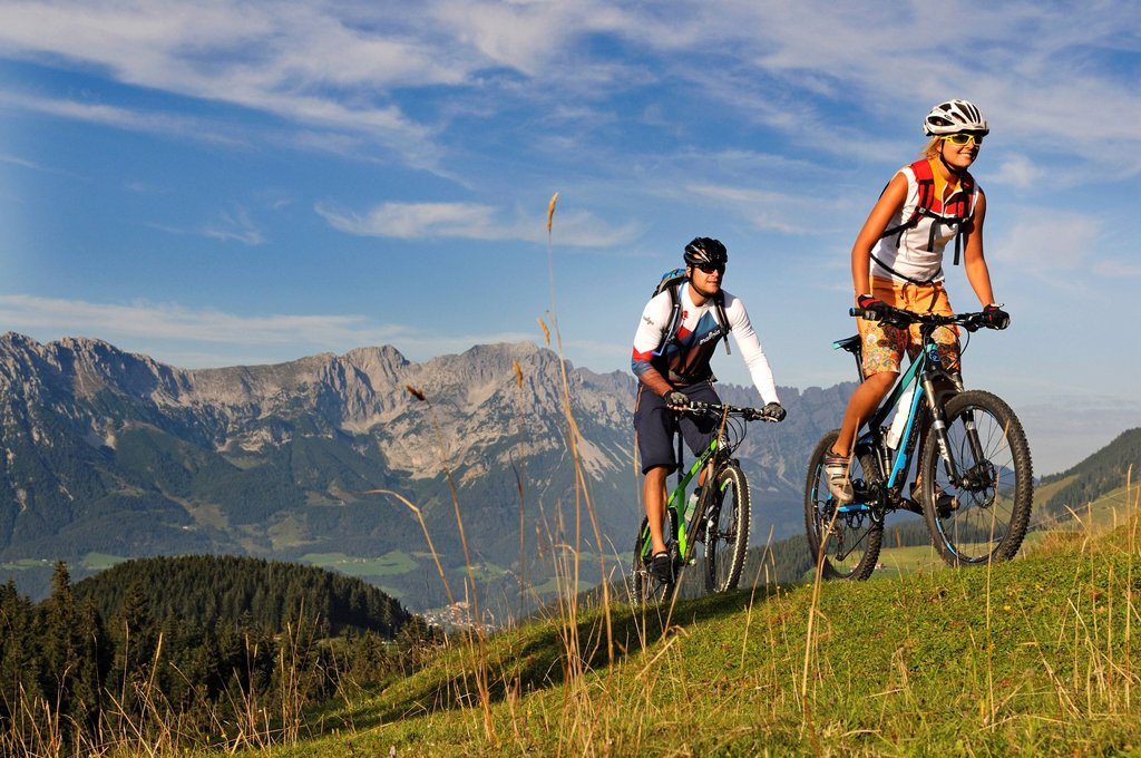 Stock Photo: 1848-648557 Mountain bikers at the Kraftalm alp, Wilder Kaiser massif at back, Mt Hohe Salve, Kitzbuehel Alps, Tyrol, Austria, Europe