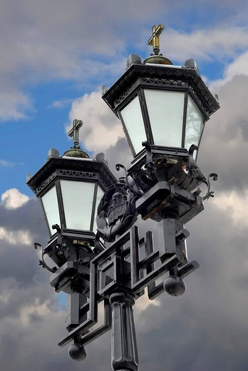 Two black iron lantern against the cloudy sky : Stock Photo