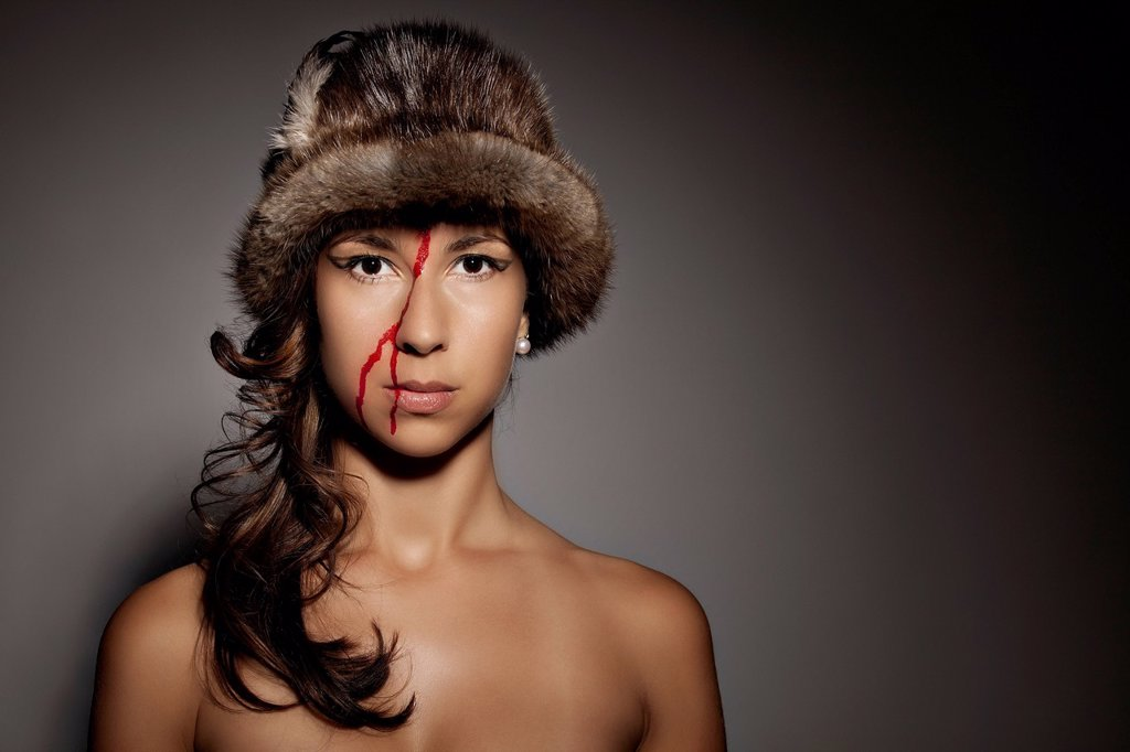 Stock Photo: 1848-649292 Woman with fur cap and blood in her face, portrait