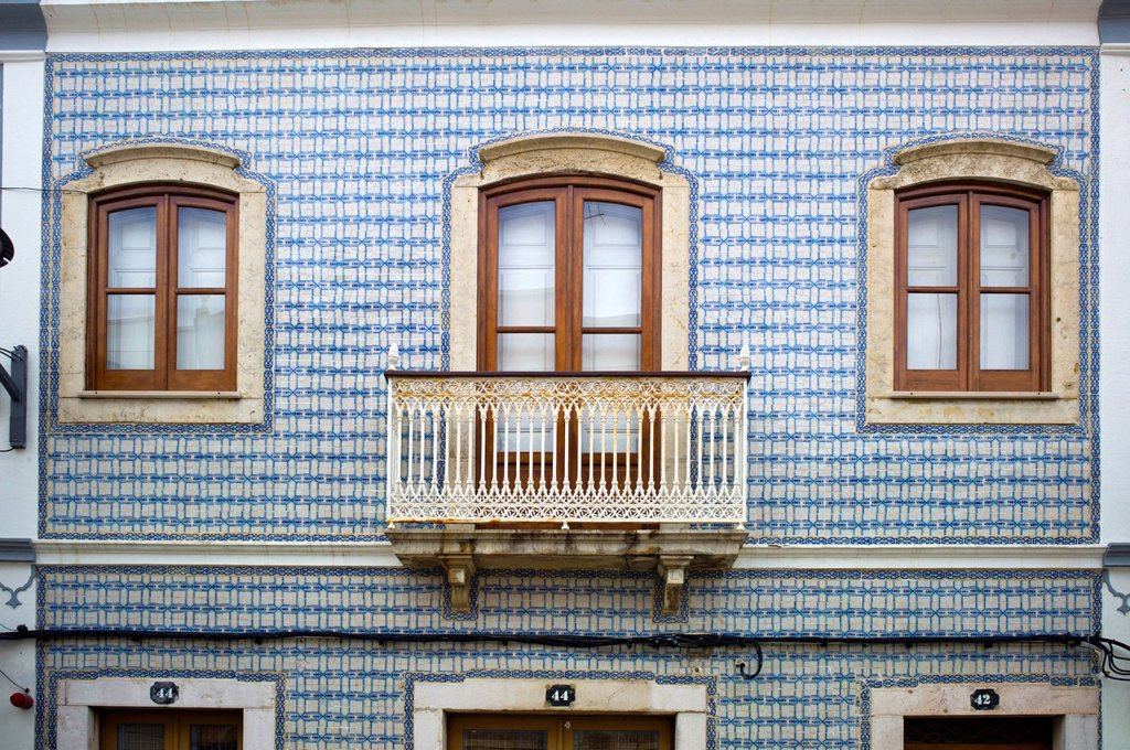 Typical, painted Azulejo ceramic tiles on a house facade, Lagos, Algarve, Portugal, Europe : Stock Photo