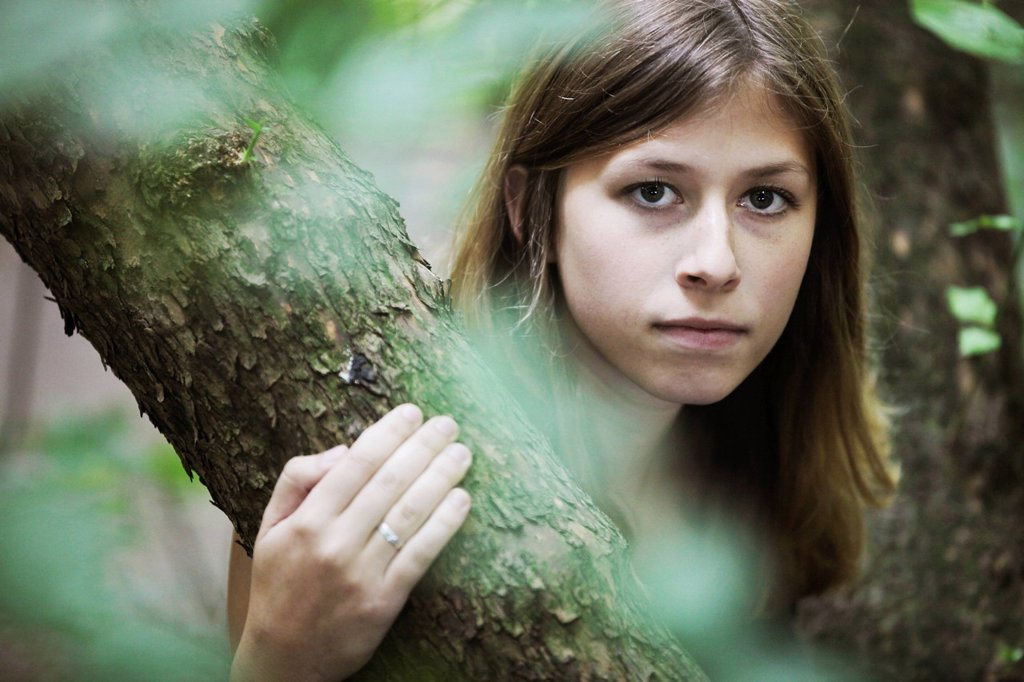 Young woman, portrait, in natural surroundings : Stock Photo