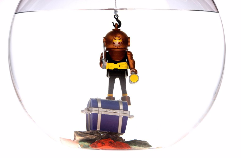 Stock Photo: 1848-649856 Toy deep sea diver with a treasure chest in a fish bowl, illustration