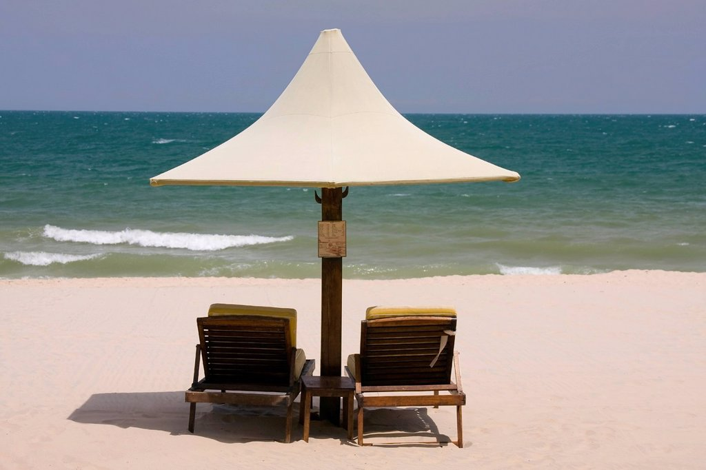 Parasol and sunloungers at the beach, Saigon Mui Ne Resort, Mui Ne, Vietnam, Asia : Stock Photo