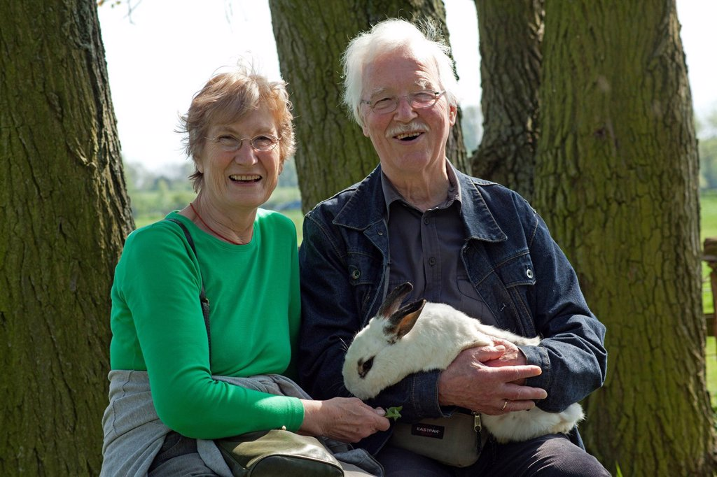 Stock Photo: 1848-650988 Elderly couple holding a rabbit at a children´s farm or zoo, Wilhelmsburg, Hamburg, Germany, Europe