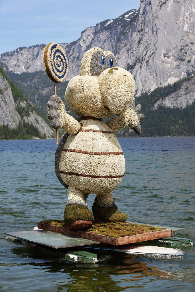 Stock Photo: 1848-652127 Koopa turtle figure made of daffodils, boat parade on lake Altausseer See, Daffodil Festival, Altaussee near Bad Aussee, Ausseerland, Styrian Salzkammergut region, Upper Styria, Styria, Austria, Europe
