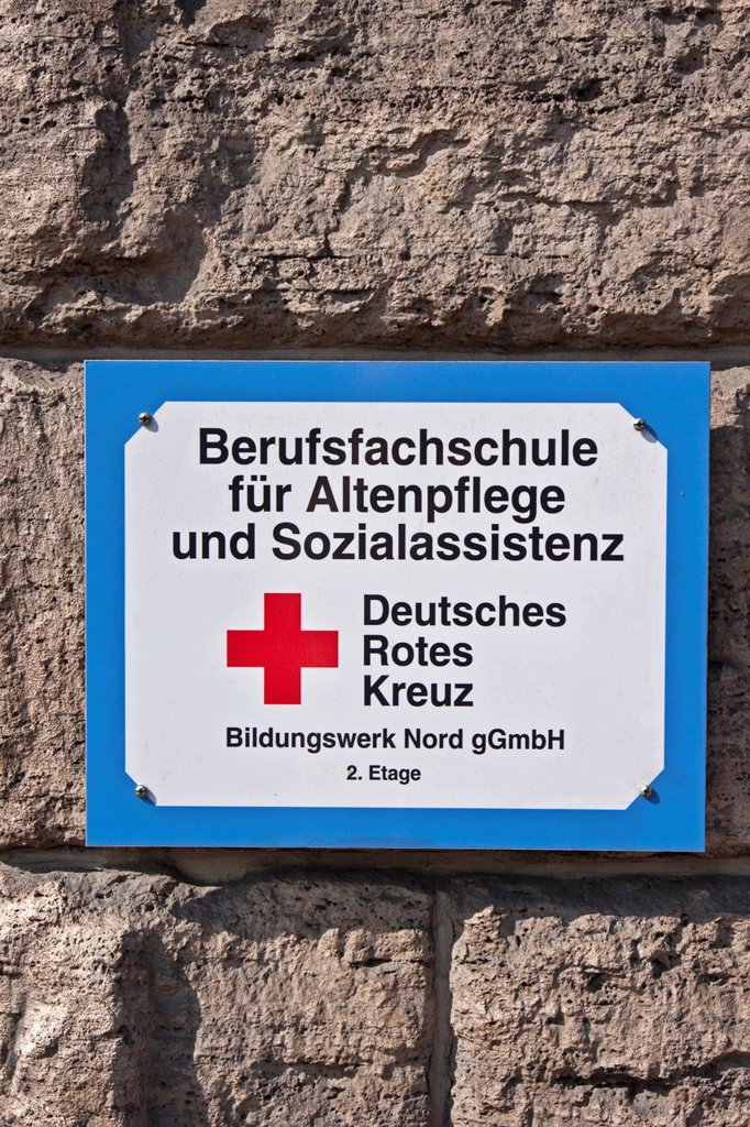 Sign on a building, Berufsfachschule fuer Altenpflege und Sozialassistenz, Deutsches Rotes Kreuz, German for Vocational School for Nursing Care and Social Assistance, German Red Cross, Berlin, Germany, Europe : Stock Photo