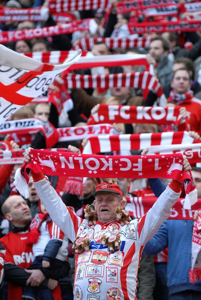 Stock Photo: 1848-652809 Cologne fans holding up their scarves, Bundesliga federal league, 1. FC Koeln _ FSV Mainz 05 4:2, Rhein_Energie_Stadion, Cologne, North Rhine_Westphalia, Germany, Europe