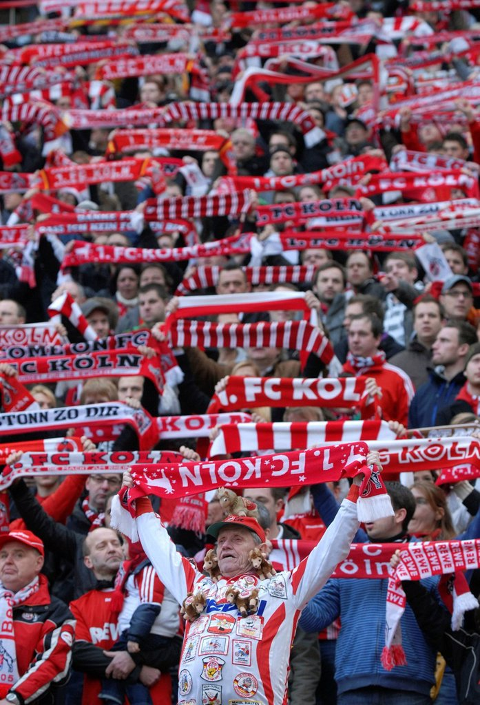 Cologne fans holding up their scarves, Bundesliga federal league, 1. FC Koeln _ FSV Mainz 05 4:2, Rhein_Energie_Stadion, Cologne, North Rhine_Westphalia, Germany, Europe : Stock Photo