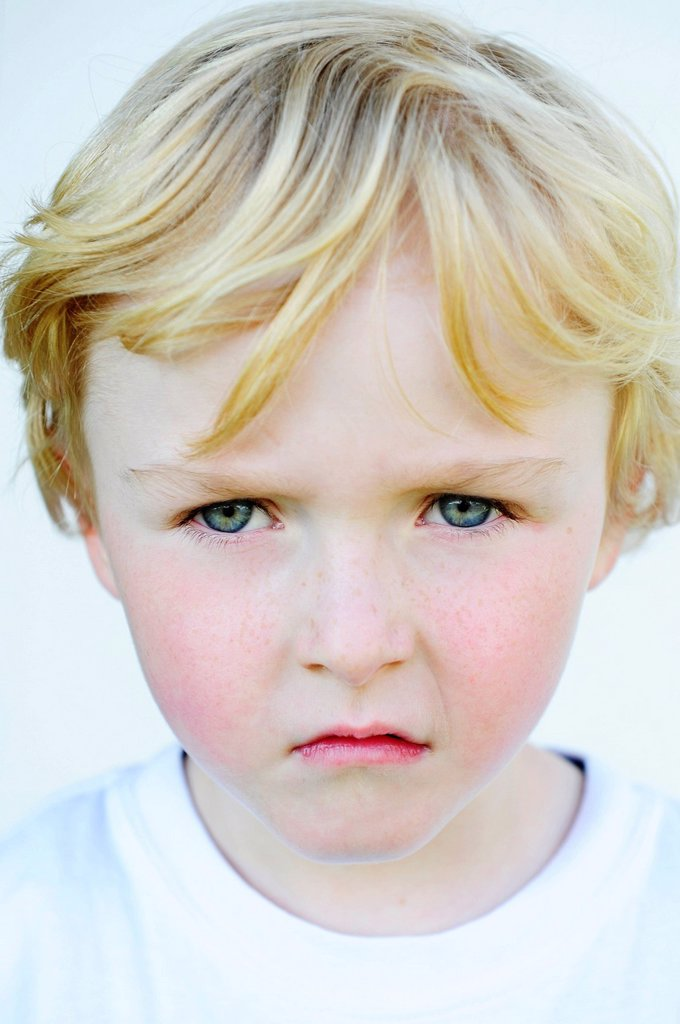 Grim faced little boy : Stock Photo