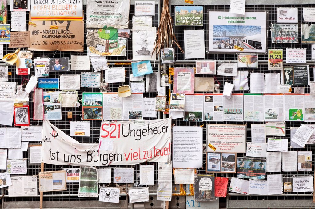 Protest posters against Stuttgart 21 railway project on a site fence, now in the Haus der Geschichte Baden_Wuerttemberg, museum, Schlossgarten, castle gardens, Stuttgart, Baden_Wuerttemberg, Germany, Europe : Stock Photo