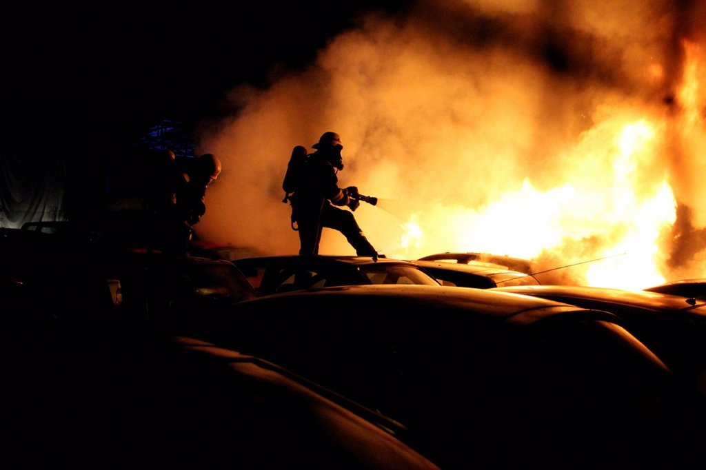 Stock Photo: 1848-653584 Arson attach on cars, firefighters trying to extinguish burning cars in the car park of a car dealer in Berlin_Schmoeckwitz, Berlin, Germany, Europe