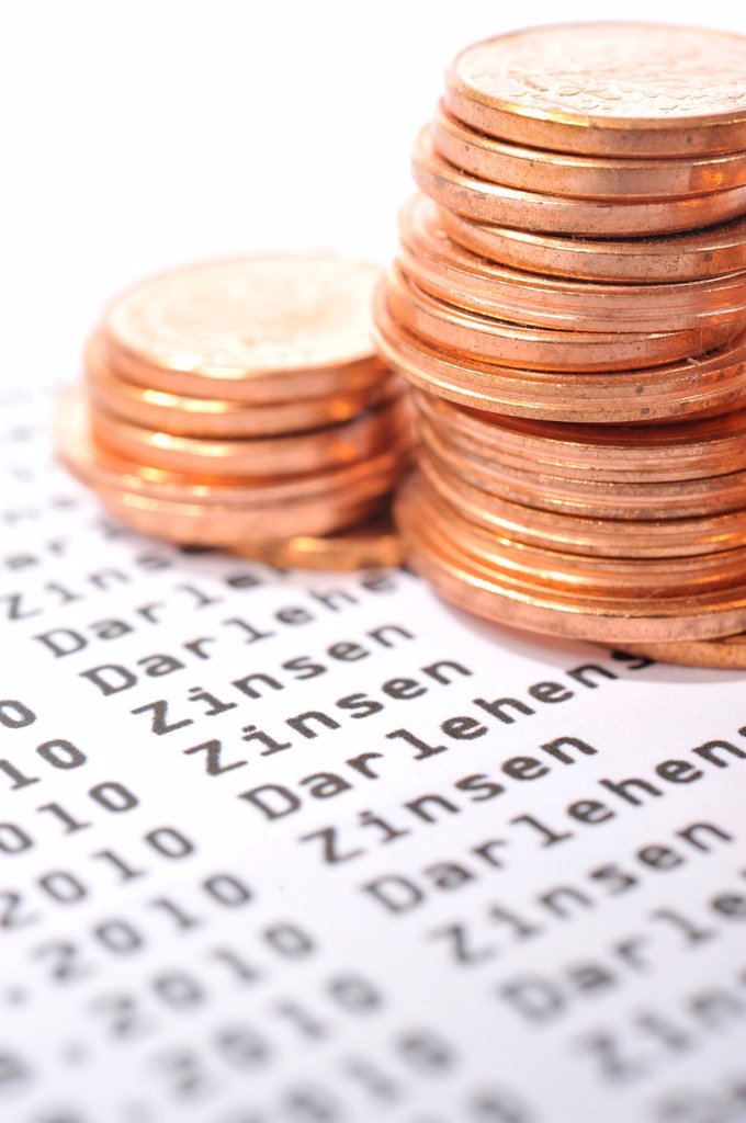 Euro cent coins on a bank statement : Stock Photo