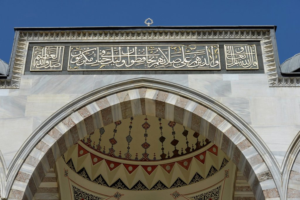 Stock Photo: 1848-654134 Inscription above the main entrance, Sueleymaniye Mosque, is considered the most beautiful mosque of Istanbul, Istanbul, Turkey, Europe