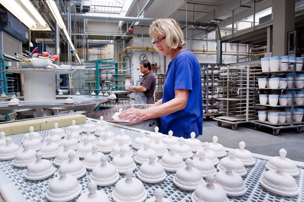 Stock Photo: 1848-654641 Employee glazing coffee pot lids from Rosenthal, in the production of tableware at the porcelain manufacturer Rosenthal GmbH, Speichersdorf, Bavaria, Germany, Europe