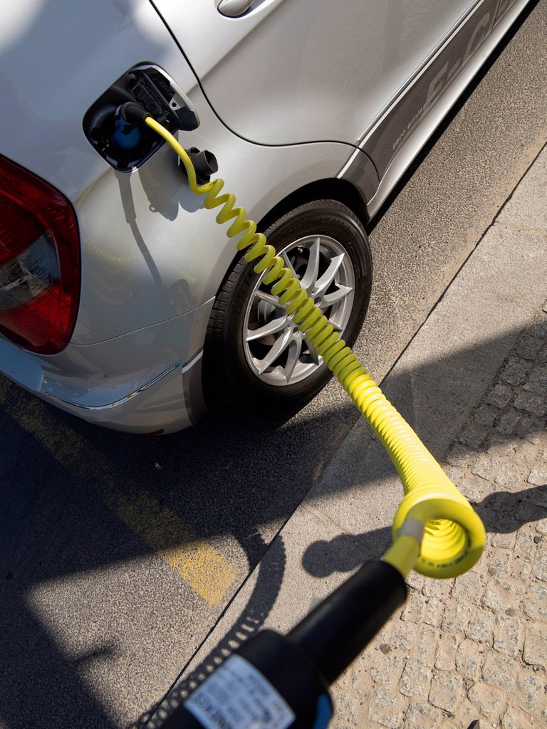 Charging cable for an electric car, Mercedes A Class E_Cell, main train station, Berlin, Germany, Europe : Stock Photo
