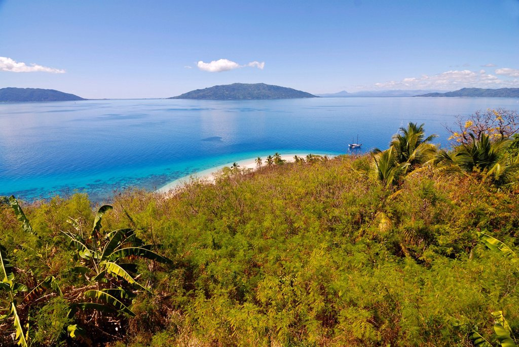 Stock Photo: 1848-654893 The crystal clear waters and white sand beach of Nosy Tanikely, in the distance, Nosy Komba, Nosy Be, Madagascar, Africa