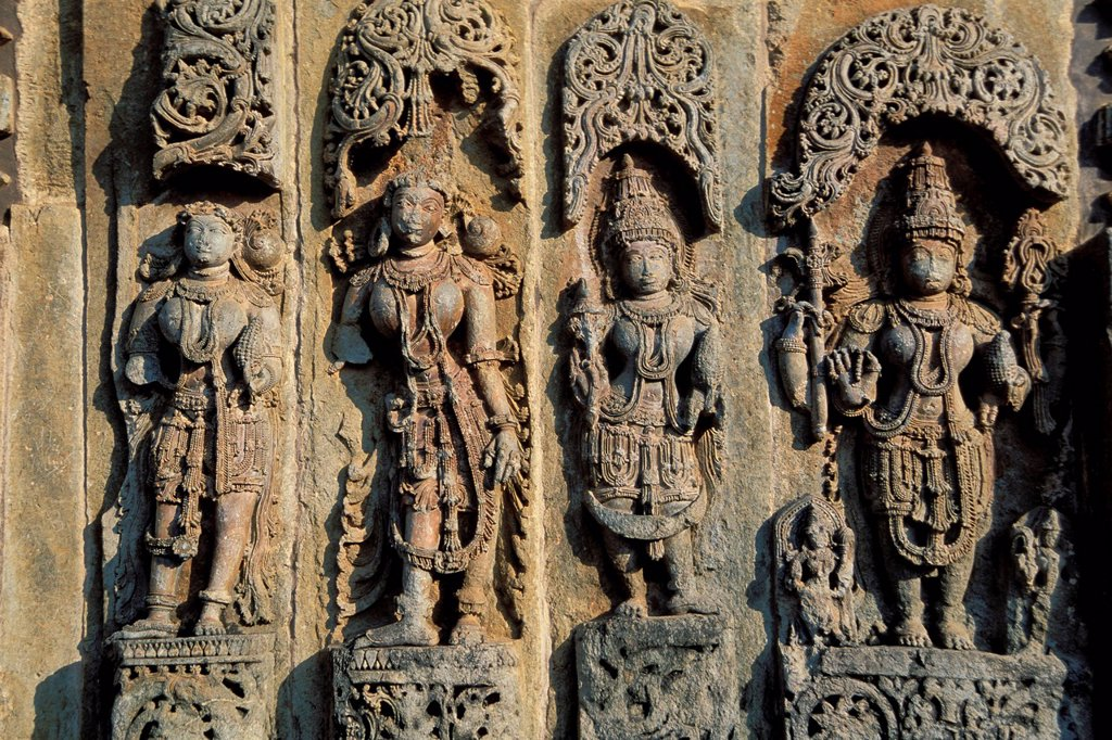 Statues of deities, reliefs on the outer wall, Chennakesava Temple, Hoysala style, Belur, Karnataka, South India, India, South Asia, Asia : Stock Photo