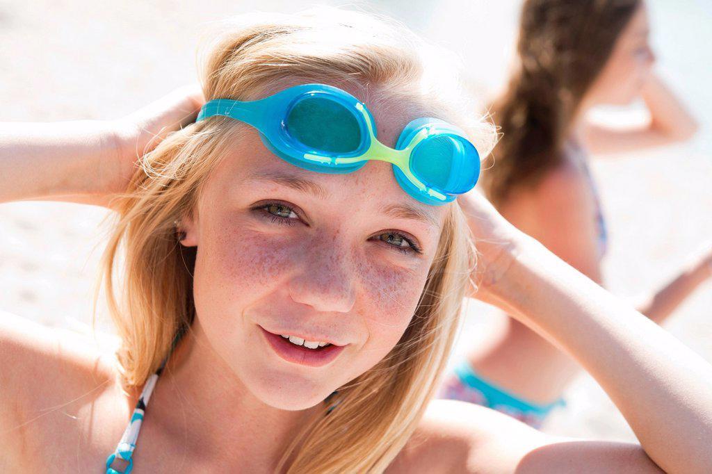 Girl wearing swim goggles, portrait : Stock Photo
