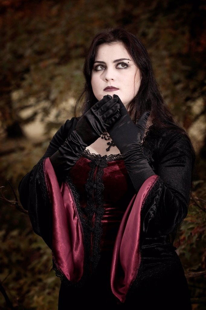 Stock Photo: 1848-656172 Woman, dressed in a Gothic style, Romantic_Gothic, standing, looking serious