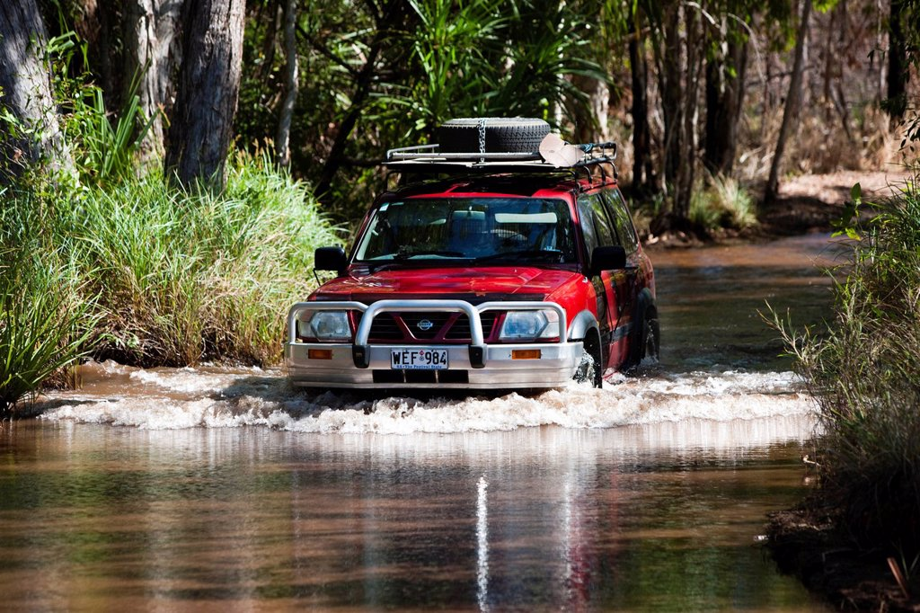 Stock Photo: 1848-656393 Four_wheel vehicle crossing a river in Litchfield National Park, Northern Territory, Australia