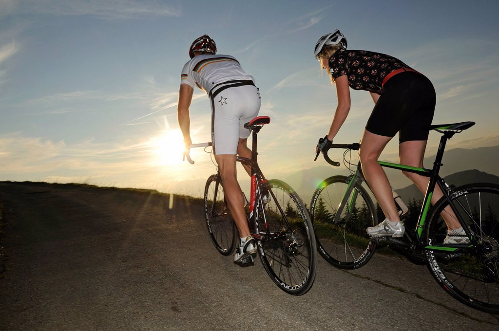 Stock Photo: 1848-656533 Couple riding racing bikes, Kraftalm alp, Mt Hohe Salve, Kitzbuehel Alps, Tyrol, Austria, Europe