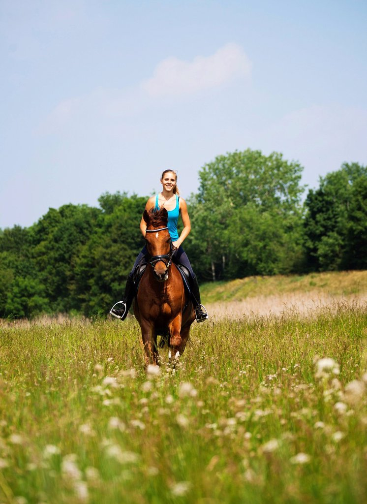 Girl riding her horse : Stock Photo